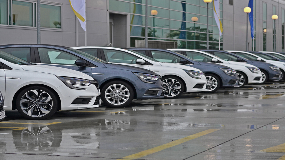 Row of sedans with alternating colours, white and grey.