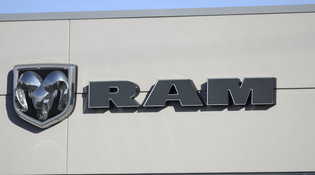 Ram logo on side of white building