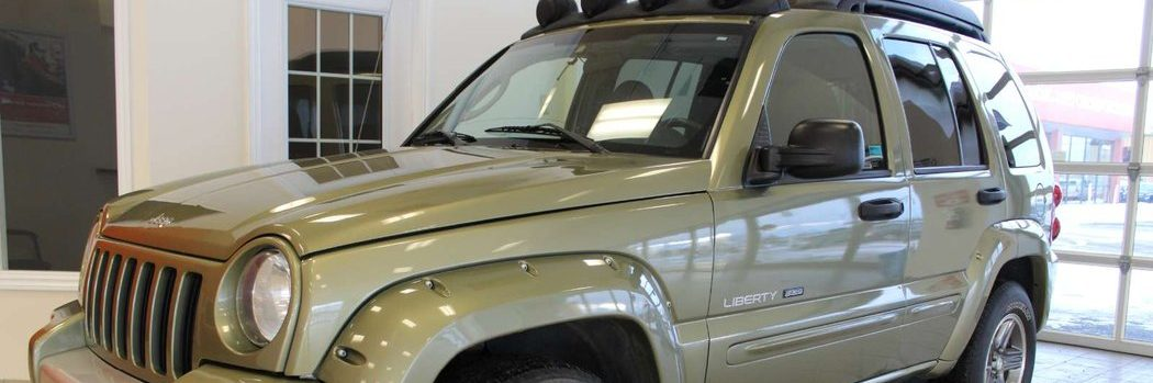 2003 Jeep Liberty Renegade in Cactus Green angled shot in Go Auto Outlet showroom