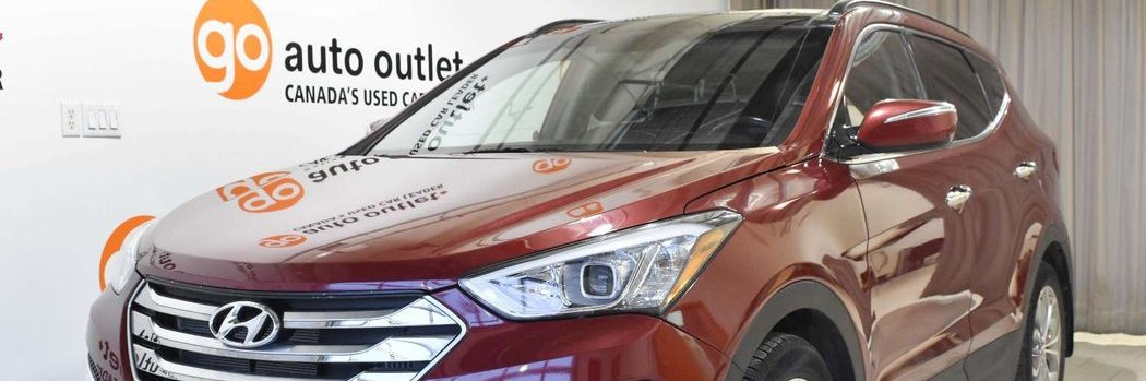 Hyundai Santa Fe in red at Go Auto Outlet showroom