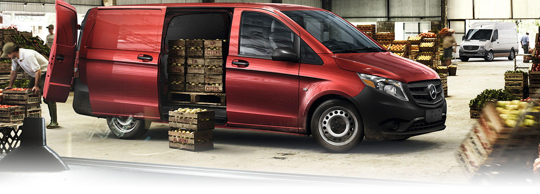 Red 2019 Metris Cargo Van with side door open