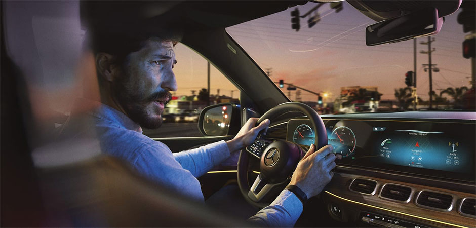 A man driving a 2020 GLE  looking out the passenger window