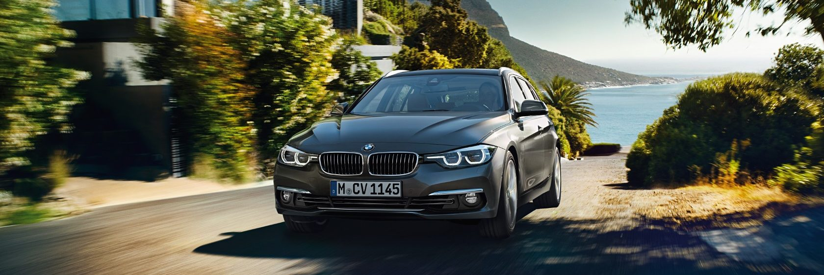 BMW 3 Series Touring driving on a road