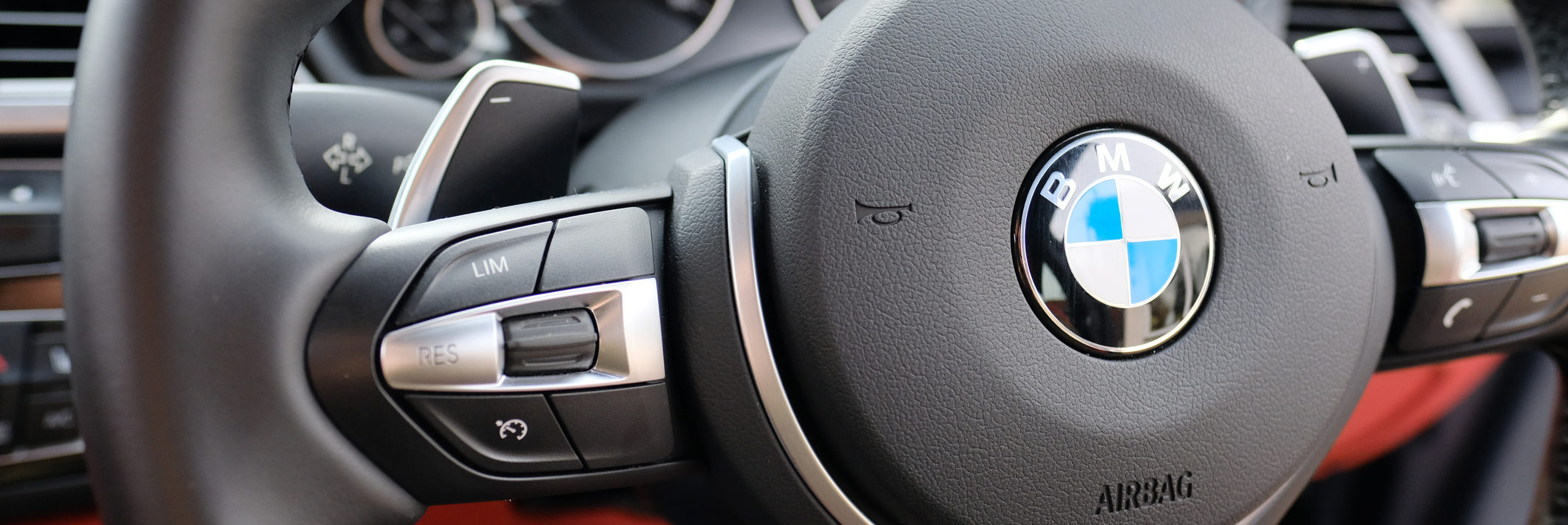 Steering wheel view of a BMW sports coupe model