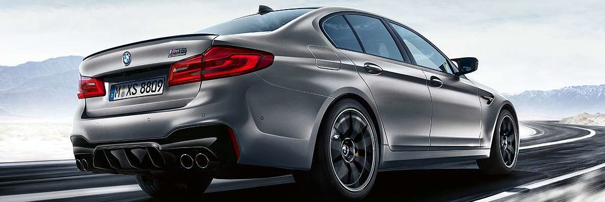 BMW M5 Competition side angle rear end view