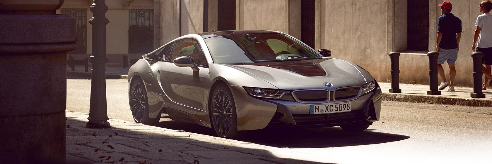 BMW i8 Coupe parked in an urban downtown area