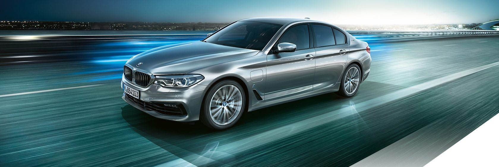 BMW 530e Plug-in Hybrid driving on a futuristic road