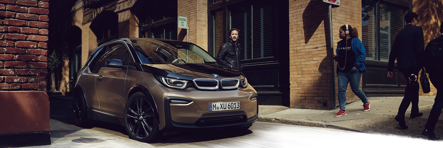 BMW i3 parked in old urban downtown area