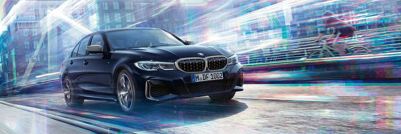 2020 BMW 3 Series sedan driving on a futuristic background