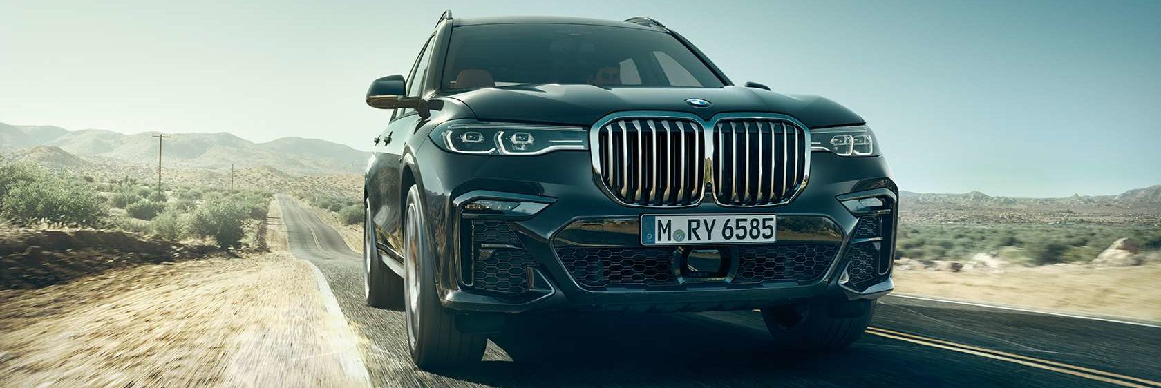 BMW X7 with laserlight headlights driving on a country road