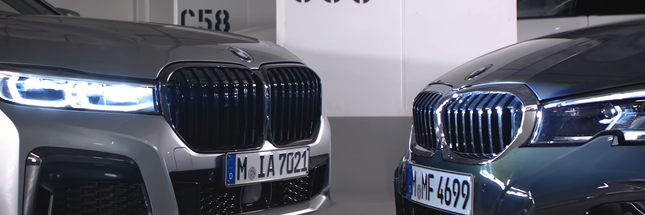 BMWs grille to grille in a parkade