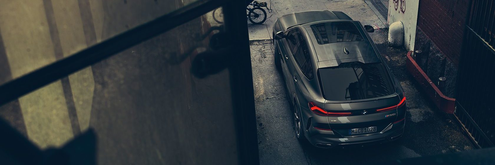 Top of the BMW X6 parked in an alley