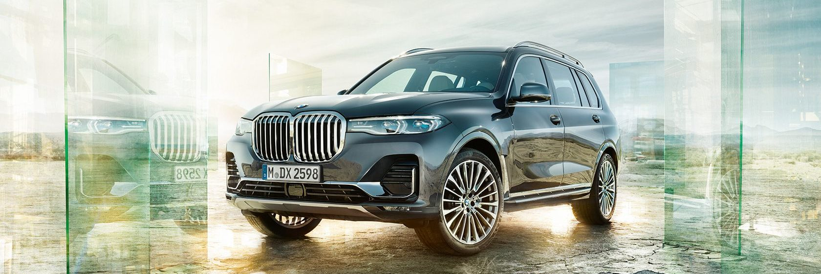 BMW X7 parked outside by glass mirror prisms
