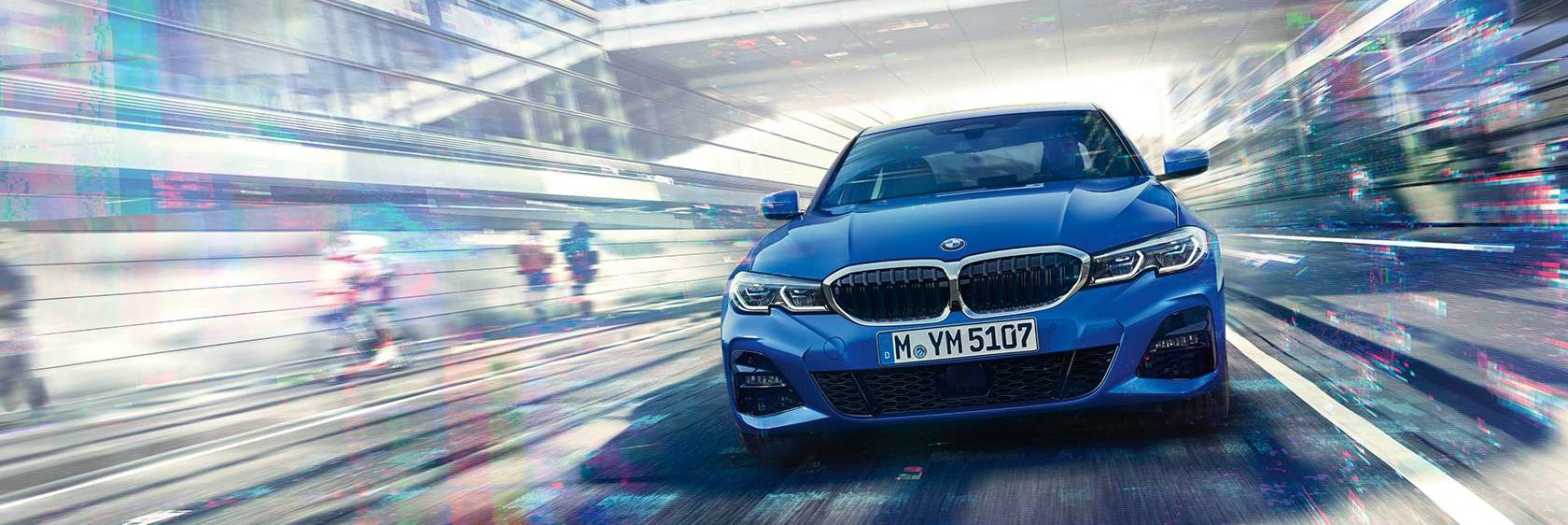 BMW 3 Series driving in a futuristic city environment