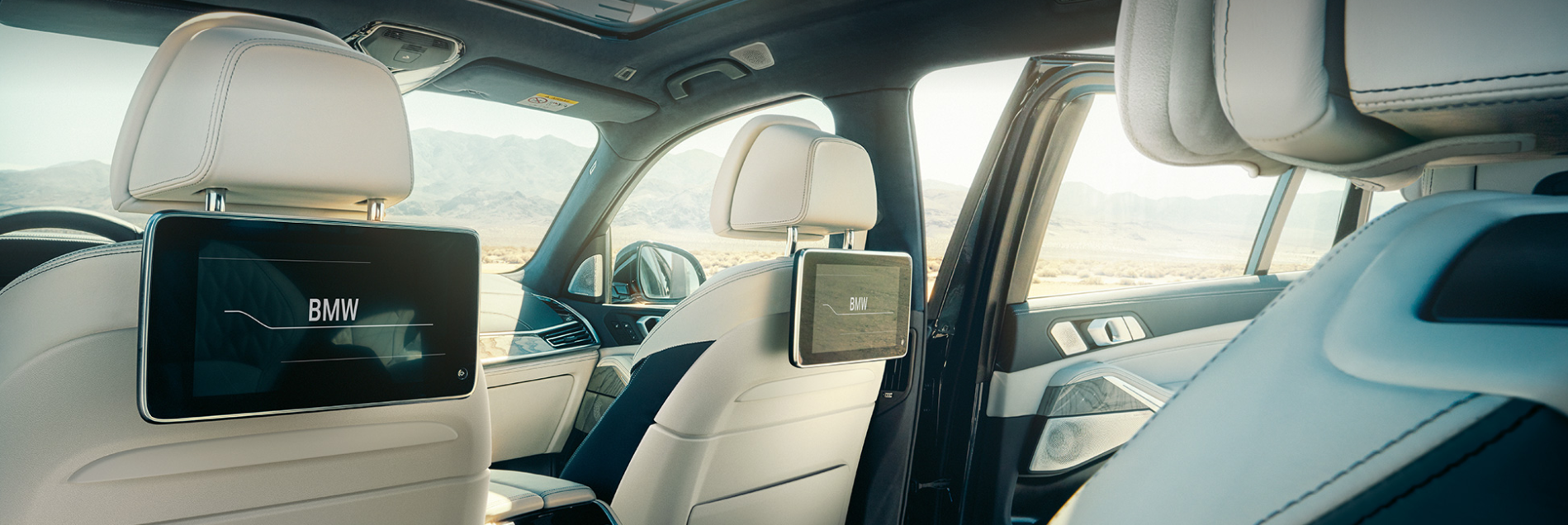 Interior of the BMW X7 with the second row seats and screens