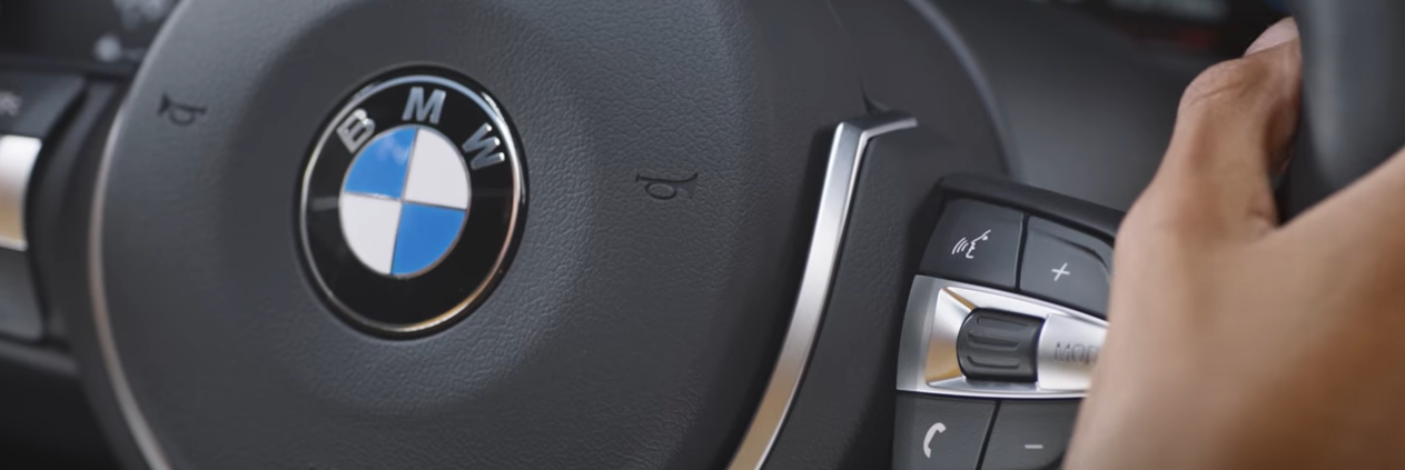 iDrive 6 voice control button on steering wheel