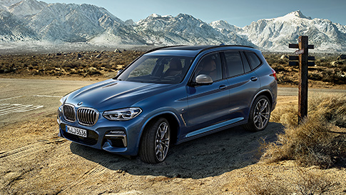 BMW X3 parked in the middle of a desert