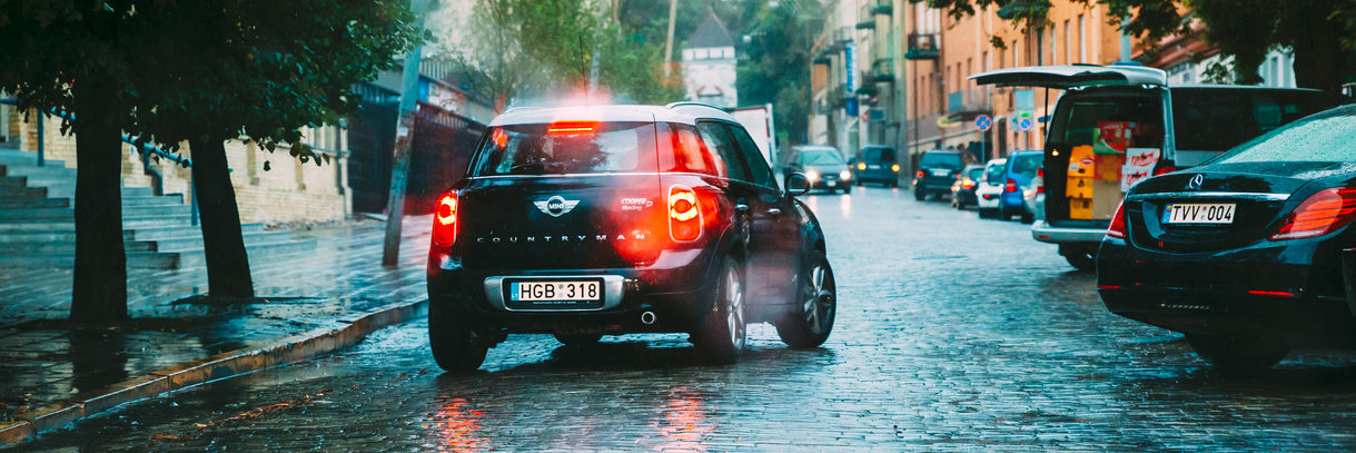 Black Color Car Mini Cooper Countryman Goes In The Rain On The S