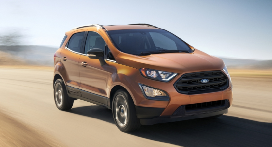 2020 Ford EcoSport driving on a country road with a blur effect