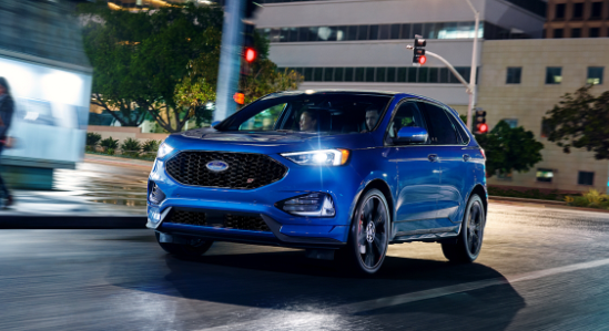 2020 Ford Edge ST driving in the city at night