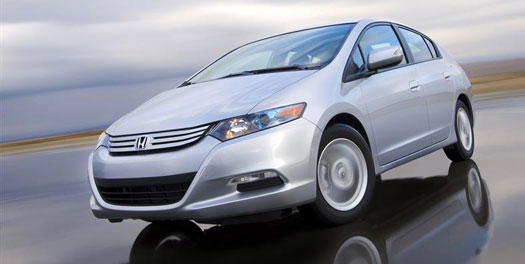 gray Honda insight, travelling on a closed course