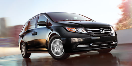 black 2015 Honda Odyssey driving on a closed course