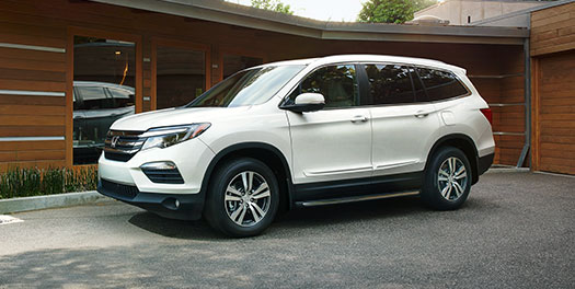 white 2016 Honda Pilot, parked on driveway at cottage
