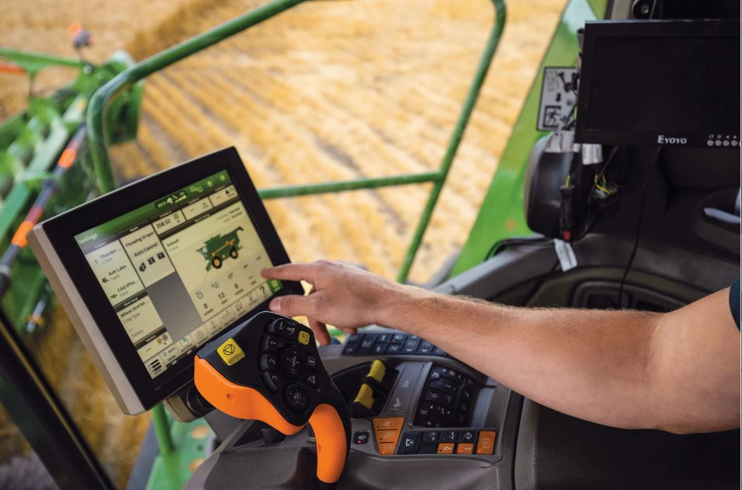 Person navigating through the John Deere AMS screen