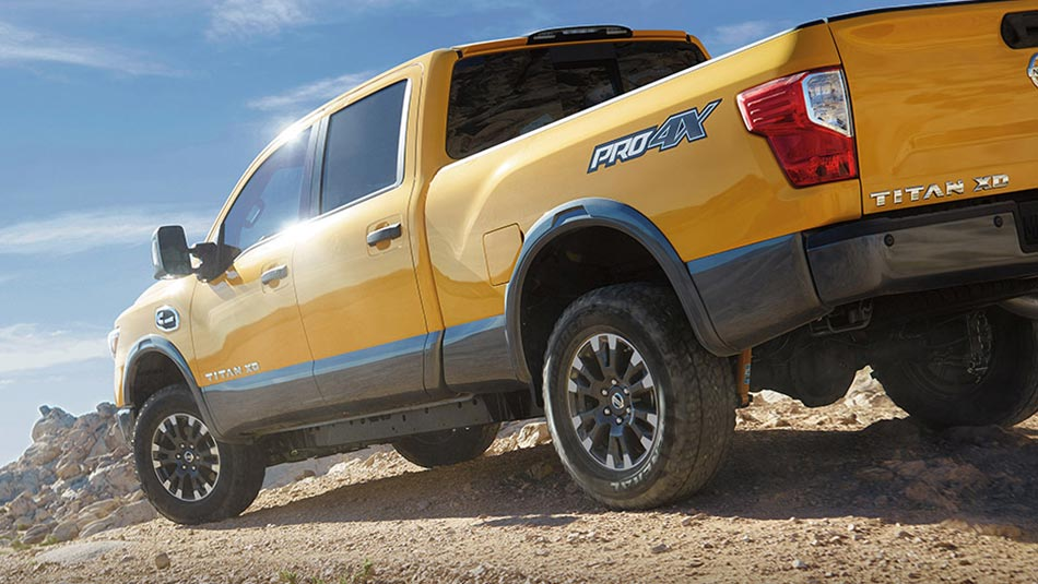 Nissan Titan XD PRO-4X  rear view, shown in Solar Flare Yellow  *U.S. colour 2018 model shown