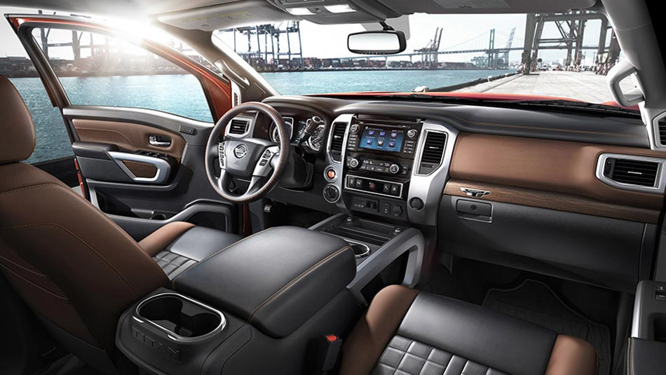 Nissan Titan XD interior shown in Black/Brown Leather, highlighting centre console  *U.S. Model Shown