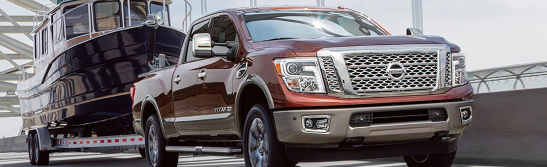 Nissan Titan XD shown in Forged Copper, highlighting towing capacity  *U.S. colour shown