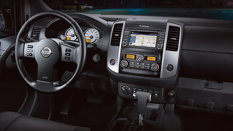 Nissan Frontier® PRO-4X® Crew Cab interior shown in Graphite Leather with optional equipment.