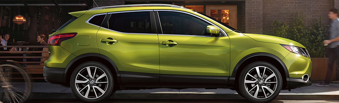 2019 Nissan Qashqai side view in Nitro Lime Metallic