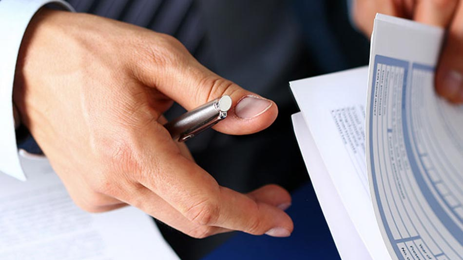 Documents being looked through by businessman