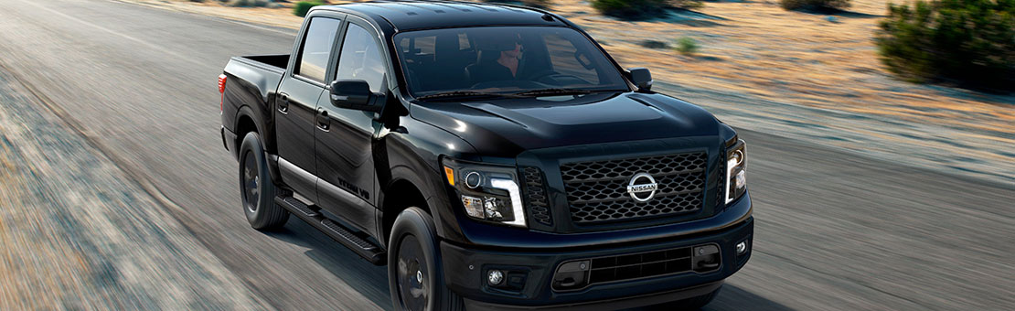 Nissan Titan Midnight Edition Exterior Rolling shot, black paint.