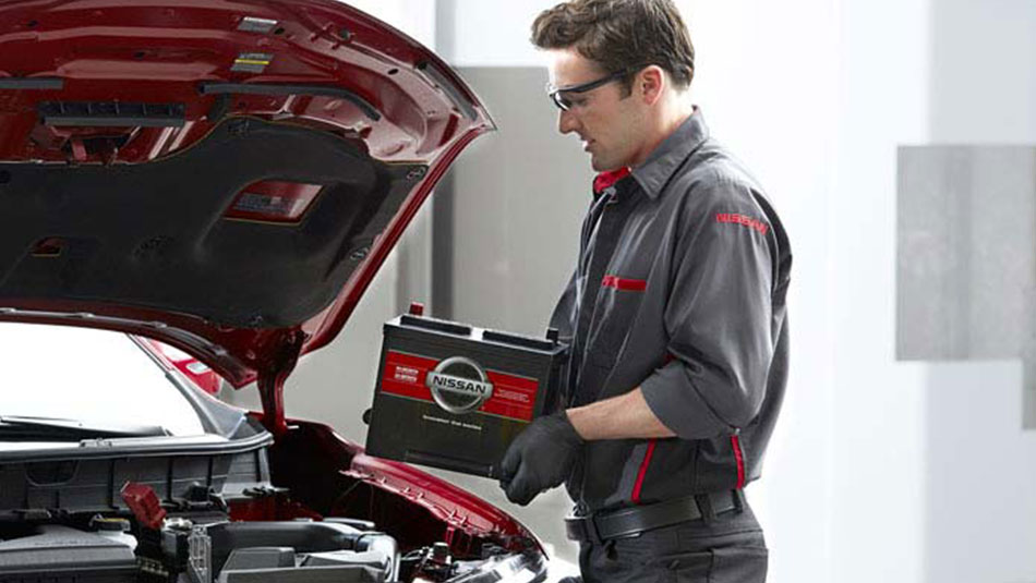 Nissan technician replacing battery