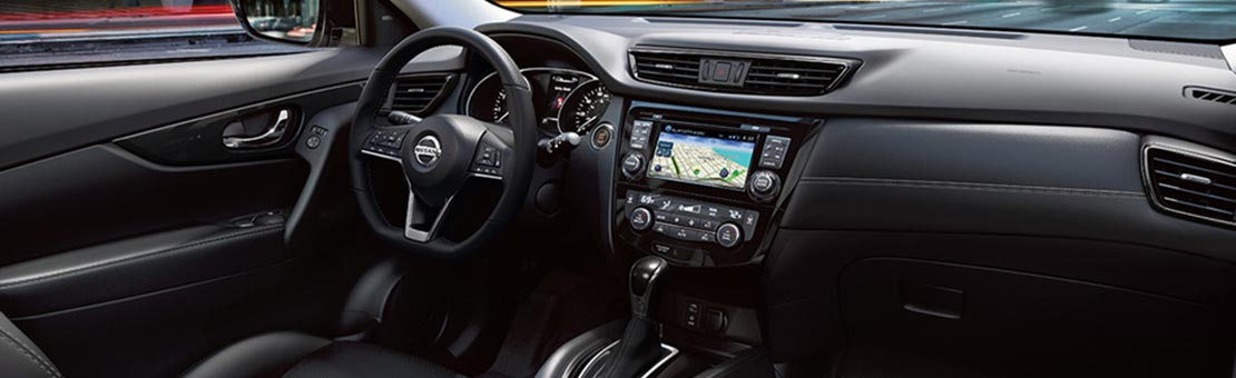 Nissan Rogue SL interior shown in Charcoal Leather.
