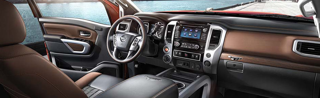 Nissan TITAN® Platinum Reserve interior shown in Black/Brown Leather.