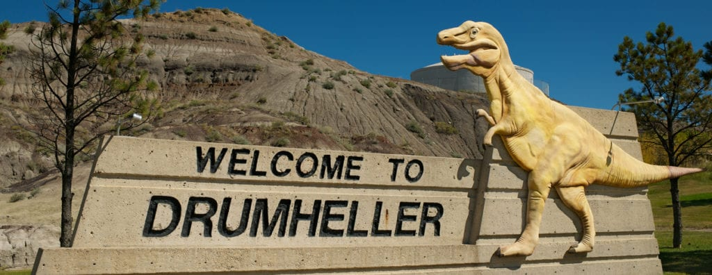 Drumheller, Canada - August 23, 2011: Welcome Monument close of road to Drumheller - famous city with archaeological excavations and Royal Tyrrell Museum of Palaeontologya.