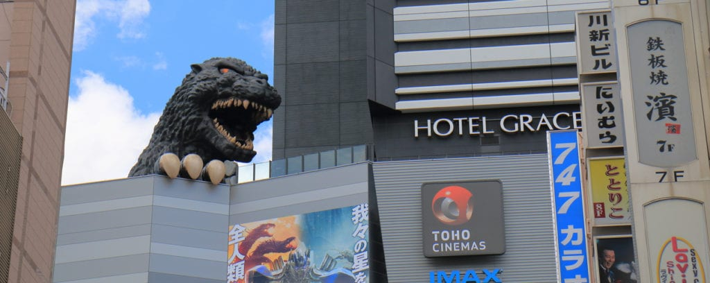 Tokyo Japan - July 11, 2017: Godzilla statue at Toho cinemas Shinjuku in Tokyo Japan. TOHO Cinemas is a Japanese film, theatre production and distribution company and famous for Godzilla movies.