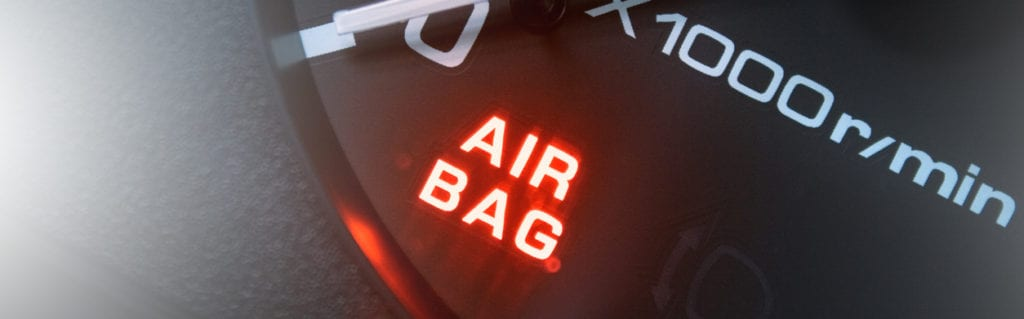 Red lighting air bag control symbol in car