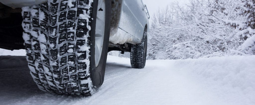 Winter Tyre on snow covered road.
