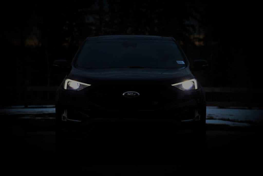 front view of the 2019 Ford Edge ST in Agate black in the dark