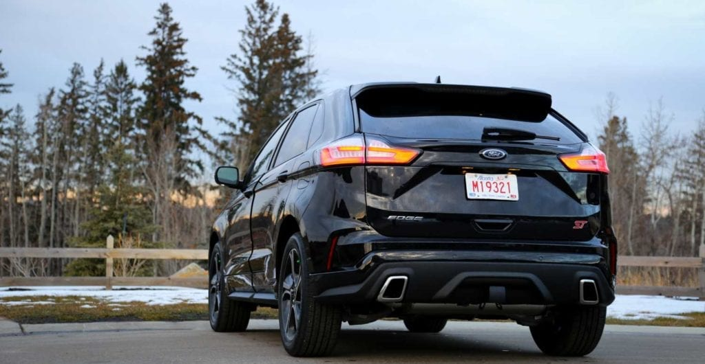 rear quarter view low angle of the 2019 Ford Edge ST in Agate black