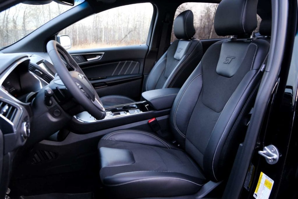 view of the front seats in the 2019 Ford Edge ST in Agate black
