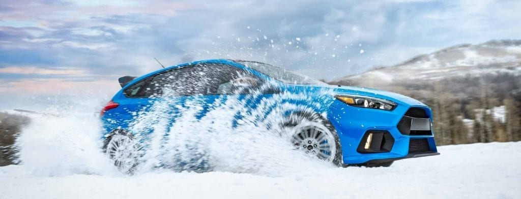 blue ford focus rs driving through snow