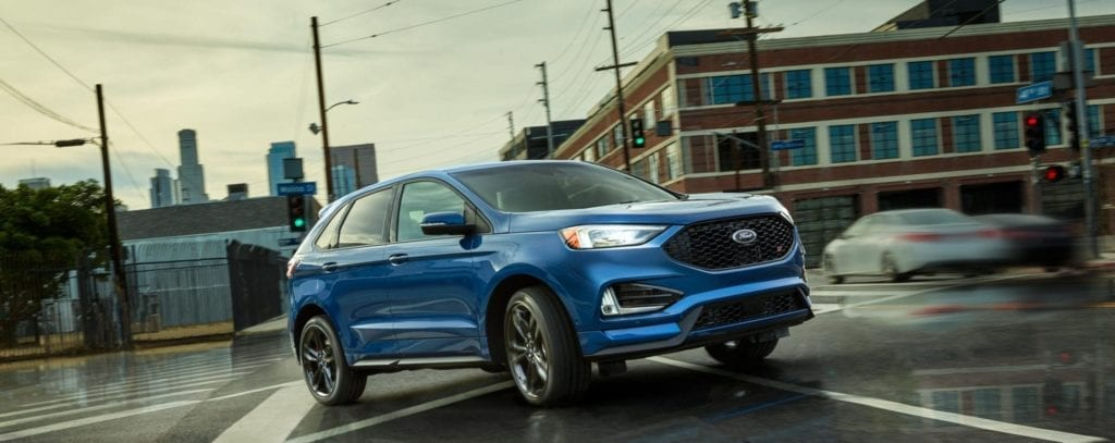 2019 ford edge st driving in blue