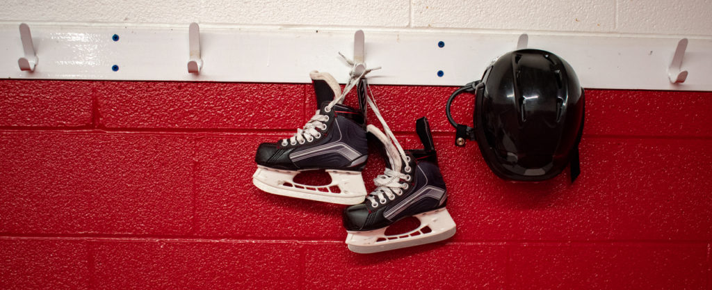 Skates hanging in red and white background