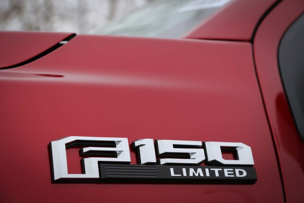 The cowl badge of a red Ford F-150 Limited