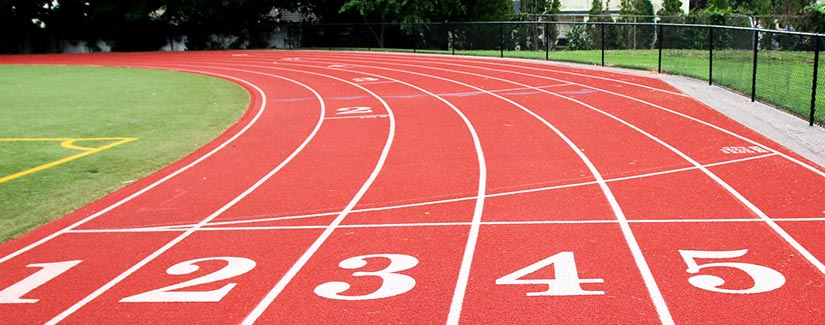 A 6 lane outdoor running track from the view of the starting blocks